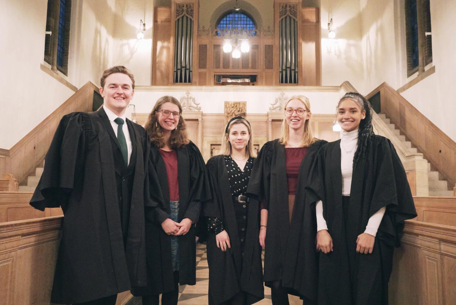A picture of five LMH Choir Scholars standing together in the LMH Chapel.