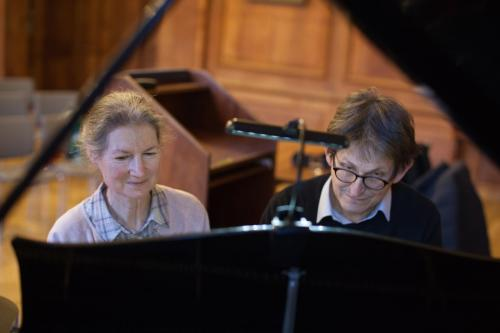 Susan Wollenberg plays the piano with Principal Alan Rusbridger