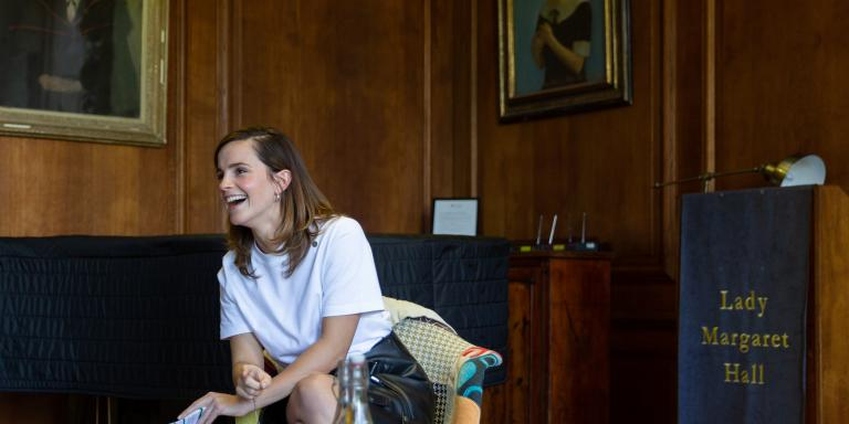 Emma Watson smiling in chair at LMH May 2019 by Amaal Said image.jpg