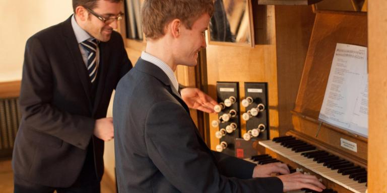 Dr Nicholas Prozzillo (director of music) and Guy Steed (Kai Feng Senior Organ Scholar)
