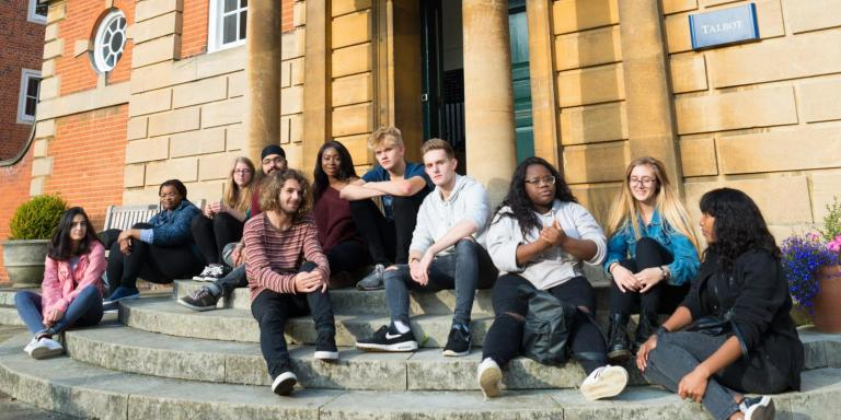Foundation Year second cohort sitting on Talbot Hall steps